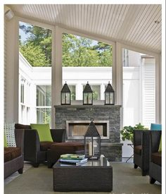 Sun room idea for off living room. fireplace, angled ceiling, big windows. perfect.