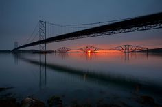 https://flic.kr/p/83nxq6 | Bridges Sunrise | A break today from my holiday snaps.  Conditions looked good for a 'shepherds' warning' dawn; a cloud front moving East. Some of the best dawns precede the worst days. It was already raining as I left the house which wasn't enough to put me off.  In some ways I wish it had put me off; in my tired fumblings with gear and umbrella in the rain the camera and tripod tumbled 5 feet down onto rocks. Camera badly scuffed, and lens unharmed but tripod yaw…