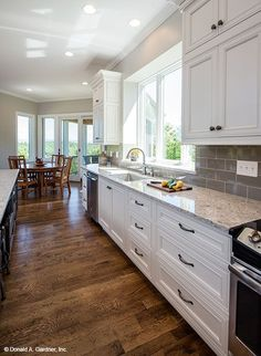 Kitchen drawers help to keep everything organized. The Butler Ridge home plan 1320-D. #WeDesignDreams