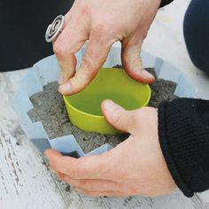 Push the smaller mold into the center of the concrete, leaving an adequate thickness for the bottom of the planter.