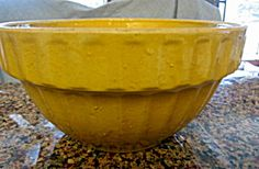 Antique yellow ware ribbed shoulder bowl. Incised no. 10 on bottom. It is 10.25 wide x 5.25 tall. No chips or cracks. Lots of tiny goosebumps in the glaze, a tiny glaze pop on interior of bowl; and some discoloration as expected, but overall this bowl is in nice antique condition. I'd estimate its age as early 1900's. It's a really neat looking bowl. Bennington? 1/12dixcs