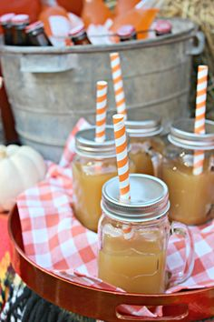 A great tip for outdoor entertaining: when you're using mason jars for drinking glasses, cut a hole in the top of the lid and use a fun paper straw. This is great for preventing spills and keeping outdoor elements out of your glass. See more of Kristin Cadwallader's ideas for Halloween or fall outdoor entertaining on The Home Depot Blog. || @gwhkristy