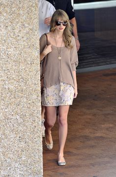 Taylor Swift Street StyleBeach chic: While on vacation, Swift stays stylish by layering a tee over her white dress. Layers always work – all year long! via StyleList