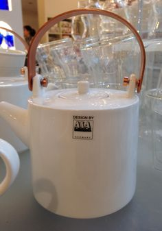 Tea kettle with bronze handles and tea drainer included