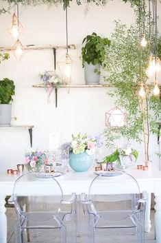 "One of the hottest wedding trends of 2016 is ""bringing the outdoors in"" making use of lots of greenery for your wedding venue. We created a roof of greenery and added some beautiful modern lighting in rose gold. - Veronique Photography"