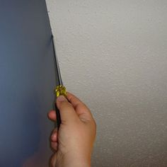 If you have textured ceilings, use a screwdriver to scrap off some to make it easier to cut in a smooth edge.