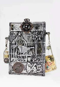 Tim Holtz die pieces under metal tape with either black paint or alcohol ink - beautiful!