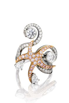 Sea Star from Boodles 'Ocean of Dreams' collection.  The pink diamond starfish at the centre of the ring clutches diamonds in its arms.