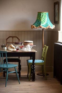 mismatched chairs create a quirky rustic look for much less money - find them at junk stores and garage sales and paint them different colours. You can also make your own lampshade covers with vintage fabrics