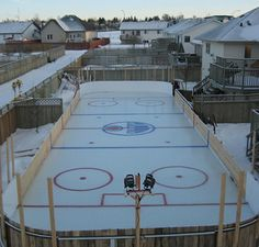 This huge backyard ice hockey rink is in Sylvan Lake Alberta, Canada. Its the creation of Shane Cyrenne and his neighbor Chris McNeil. 9000 gallons of water was used to make the rink, and 70 hours in the shop to build the mini-Zamboni. D Huery Backyard Hockey Rink, Backyard Ice Rink, Outdoor Rink, Ice Hockey Rink, Backyard Playground, Hockey Mom, Hockey Stuff, Nice Backyard, Backyard Ideas