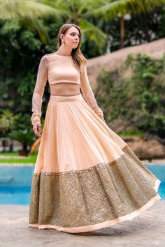 Prathyusha Garimella Peach Lehenga With Gold Sequin Border.