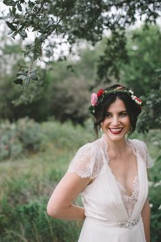 Red lips, floral crown, and lacy dress | Photo by Geoff Duncan
