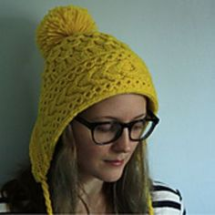 This hat was inspired by EZ's Ski Bonnet, but mine is knit flat then joined in the round instead of steeked. The front band is double thickness over the ears for extra warmth, and the pom-pom is extra-big for added fun!