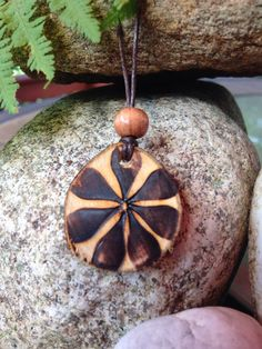 This is a handmade Flower wood burned (pyrography) necklace. It was hand cut from beechwood, sanded and wood burned. It is unfinished wood. The cord is
