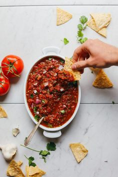 How have Igotten 5 years into writing a food blog and not provided a simple red salsa recipe? How dare I? How could I? I know. Shame, shame. But I realized this recently and am excited to fill the void with this EASY, 10-minute Red Tomato Salsa! Let's do it!  I did quite a bit of experimenting for this 10-minute, 8-ingredient, 1- bowl recipe. Easy Red Salsa from Minimalist Baker → :: Food