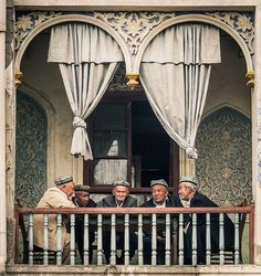 Local men chat on a balcony in #Kashgar , #China