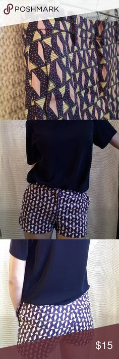 "H&M Pink and Navy Diamond Patterned Shorts H&M navy shorts with a spattering of magenta spots, peach diamonds, and yellow striped triangles. Really fun, vibrant pattern and fabric has a bit of stretch to it. Condition:  Worn only a handful of times, so there are no signs of wear and tear. Flat Measurements:  -Waist is 14.5"" -Shorts are 10"" long Material: -98% Cotton -2% Elastane H&M Shorts"