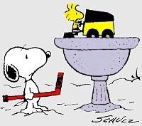 Snoopy with a hockey stick and Woodstock on a zamboni...