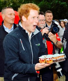 hrhroyalty:  Trip to New Zealand, Christchurch, May 12, 2015-Prince Harry gives out cupcakes during a visit to the University of Canterbury