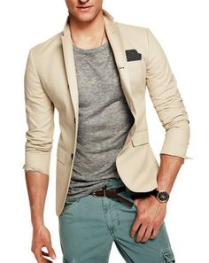 Rock a beige sport coat with green cargo pants for an easy to wear, everyday look.   Shop this look on Lookastic: https://lookastic.com/men/looks/blazer-crew-neck-t-shirt-cargo-pants/17178   — Black Pocket Square  — Grey Crew-neck T-shirt  — Beige Blazer  — Dark Brown Leather Belt  — Black Leather Watch  — Green Cargo Pants