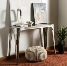 The industrial-chic Classic iron console table by Safavieh will brighten an entry hall or living room with an air of masculine sophistication. Crafted of by metal artisans, each one of a kind console is beautifully detailed with riveted corner patches. #Entryway #IndustrialLook #UniqueDesign #Safavieh