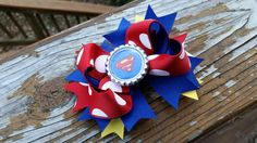 Check out this item in my Etsy shop https://www.etsy.com/listing/212480570/blue-red-yellow-superman-hairbow-clip