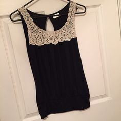 Boutique Style Top Black top with cream lace accented with silver studs, keyhole at back neck. So cute!! Tops