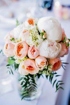 Peachy rose + peony centerpiece: http://www.StyleMePretty.com/australia-weddings/south-australia-au/2014/01/21/rustic-chic-vineyard-wedding/ Emma Sharkey Photography