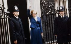 Margaret Thatcher waving from the doorstep of 10 Downing Street.