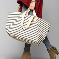 "Baggy Weekend Bag in Stripe Sailor NWT The Baggu Weekend Bag has 2 sets of handles, one for carrying, one for over the shoulder. Bag has a top zip closure and an interior zip pocket | 25"" x 16"" x 15"" 