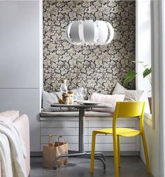 No dining room? No problem.  Make a cozy nook using storage shelving to separate things a bit (maybe even wallpaper a portion of a wall). Add a small table and hanging pendant and you're set!