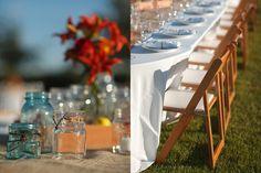 Vintage mason jars and a captains table for the head table.  Wedding decor Farmers Market Themed