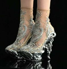 One of my favorites in McQueen feet. I love the sculpted heel and platform, and the ethereal nearly-bare-footed look of the embroidered nude uppers.