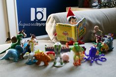 Elf reads a book to Toy Story characters
