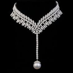 @tufenkjian. Classic and bold design makes this lovely necklace. Set with diamonds and white pearl, this piece is for the daring yet delicate woman! #TufenkjianJewelry