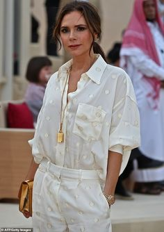 What a fabulous woman! Victoria Beckham looked sensational in spotty cream co-ords as she ...