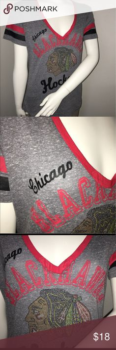"""G-III 4her Chicago Blackhawks graphic T-shirt sz M Thank you for viewing my listing, for sale is a women's, short sleeve, NHL, Multi colored, graphic T-shirt.  Chicago Blackhawks The chief is very shiny and colorful, like sequins for the design Sz: M Brand: G-III 4Her by Carl Banks  Excellent condition. No rips or stains. If you have any questions or would like additional photos please feel free to ask.  From under one arm to under the other measures appx 19"""" the top of the shoulder to the…"""