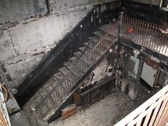 Fire-blackened stairs from abandoned mental hospital in Rockland, NY