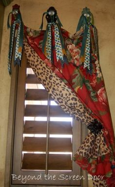 Funky upcycle of an old window treatment by the additional of animal print lining and multiple ribbon ties. window curtains, old windows, laundry rooms, window treatments, animal prints, laundri room, screen doors, funki upcycl, bathroom windows