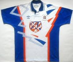 Luton Town home shirt of 1992.    This marked many changes. Firstly the change of the white shirt, navy shorts of the later Bedford years. Also the sponsor USA marked the change from the legendary Vauxhall / Bedford sponsor.    This was a radical shirt change to say the least. I had one of these though, with a home made, hand stitched number 9 (Harford) courtesy of my nan.