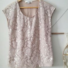 F21 Tan sequin sleeveless top This amazing tan color top has sequins on the front and t-shirt material on the back. It is very eye catching in the light and comfortable at the same time.  It is a size Medium and the label is Forever 21. Forever 21 Tops