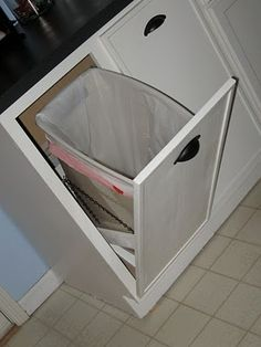 This would be amazingly handy...and look so much better than just freestanding garbage cans!