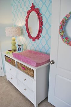 Lilly Pulitzer inspired girl nursery; love the mirror above the changing table.