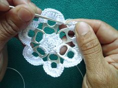 Crocheting a flower using pull tabs from soda cans!