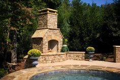 Stacked stone fireplace with arched keystone