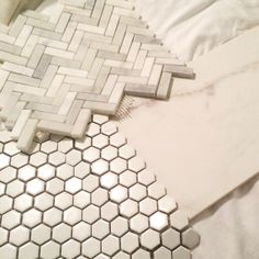 Upstairs shower remodel. Large white porcelain in walls, small hex on floors, herringbone marble in niche.