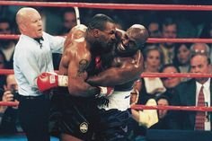 Mike Tyson bites the ear of Evander Holyfield as referee Mills Lane tries to separate the two during their heavyweight title fight on June 28, 1997 at the MGM Grand Garden Arena in Las Vegas. Tyson...