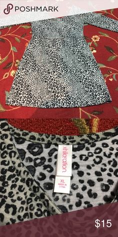 Animal print dress from Xhilliration - Xl Animal print dress from Xhilliration - Xl Bought this from another posher but I don't like the way it fits me. 95% polyester 5% spandex Xhilaration Dresses