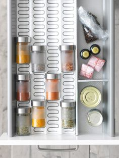With an organized, in-drawer spice rack, you won't ever risk mistaking the cayenne pepper for paprika again.