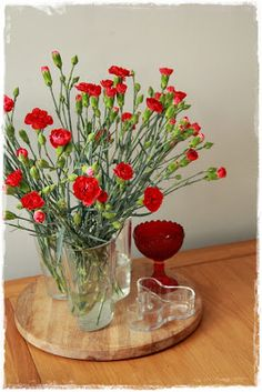 Red flowers in Aalto vase, beautiful!